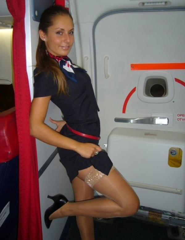 Real stewardess showing some leg; Amateur Uniform